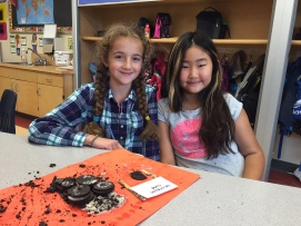 Andjelina and Katie have created a cookies and cream flavoured ice cream cone with their Oreos. They had to use every one of their Oreos in their sculpture. The girls enjoyed the project but Katie did not like that her hands got dirty.