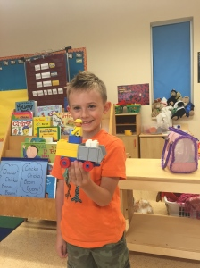 Jake couldn't wait to share what he built during center time in Kindergarten. He explained to me step by step how he created his dump truck with driver!