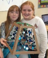 Hailey and Amy were challenged to create a lamp shade to fit a lamp that Mr. Unruh made out of recycled parts.