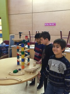 Adam, Nick and ______ with the beginnings of their marble structure.